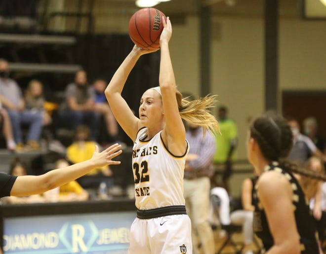 Fort Hays State's Whitney Randall looks to pass from the top of the key last Saturday against Emporia State.
