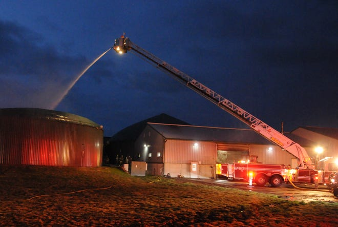 Crews fight a fire at Scenic View Dairy in Fennville Thursday morning.