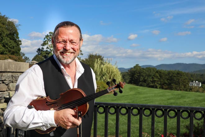 Violinist Paul Rene McIntire of Asheville, shown here at the Biltmore Estate, will play Sunday at Saint Paul Mountain Vineyards.