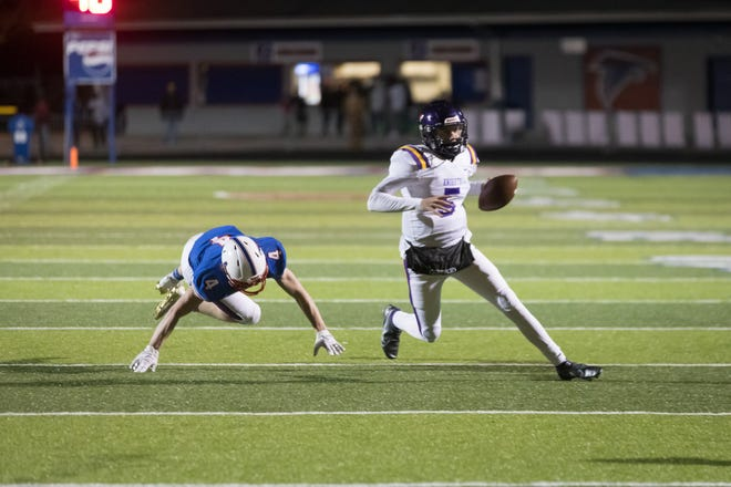 North Henderson quarterback Jaxson Willis evades West Henderson's Hunter Wallace (4) as the Knights drove down the field for their second and winning touchdown last week at West. [PAT SHRADER/ SPECIAL TO THE TIMES-NEWS]