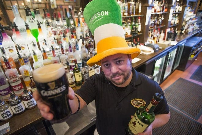 In this 2015 photo, bartender Matthew Ritterbusch prepares for the St. Patrick's Day celebration at Kelleher's on Water, 619 SW Water St. in Peoria.