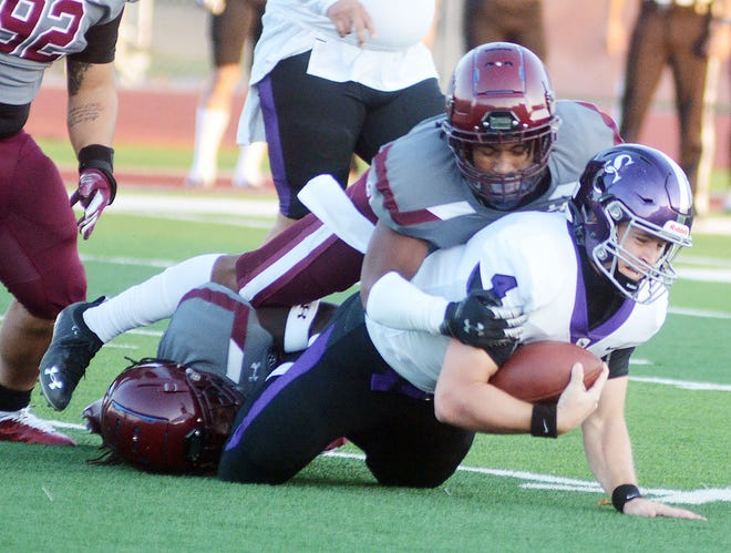 Bethel sophomore Dominic Brown brings down a ball carrier from play earlier this season. The 11th-ranked Threshers play at 1 p.m. Saturday at Tabor.