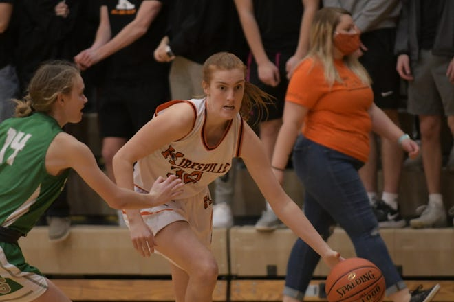 Kirksville's Erica Treasure dribbles down to the paint during the second half of Wednesday's sectional game against Smithville.