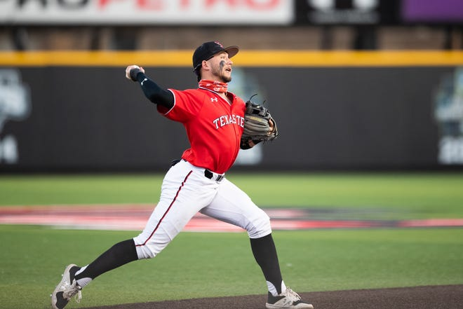 Texas Tech shortstop Cal Conley attempts to throw the ball during a nonconference game Wednesday against Gonzaga at Dan Law Field and Rip Griffin Park.