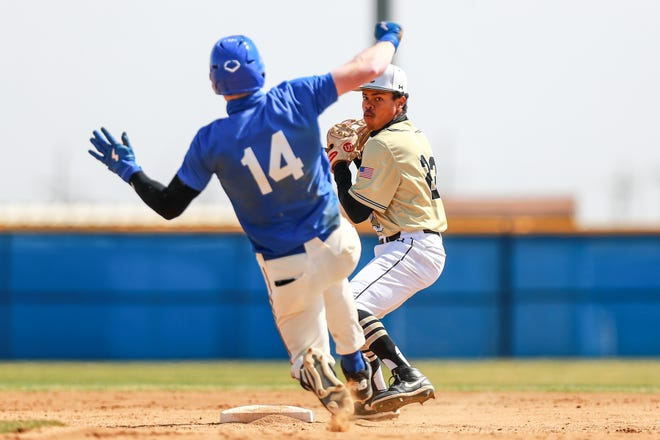 Lubbock High's Jayan Hambrick (23) attempts to turn a double play against Lubbock High during the 2021 First Bank Classic on Thursday, March 11, 2021, at Tiger Field in Wolfforth, Texas.