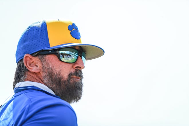 Frenship head coach Chad Reynolds looks back at his dugout while coaching third base against Lubbock High during the 2021 First Bank Classic on Thursday, March 11, 2021, at Tiger Field in Wolfforth, Texas.