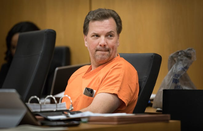 Former Lakeland City Commissioner Michael Dunn looks back to supporters in the courtroom during a bond reduction hearing in court in Bartow in October 2018.