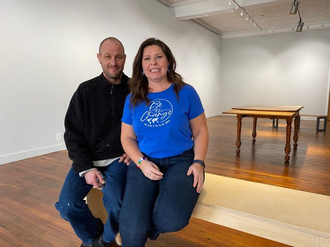 Jason Hoffman left and Marcia Cook sit inside the Lincoln Arts Institute with plans to make the space available for exhibitions and other cultural events.