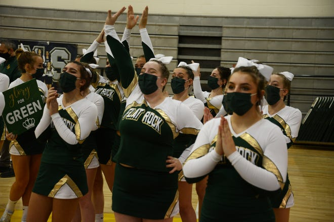 Flat Rock's competitive cheerleading team welcomes the fans before the start of the Huron League Meet.