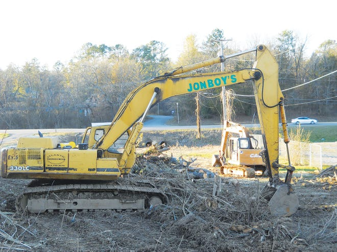 Heavy machinery sits on the lot of the demolished Brannon House.