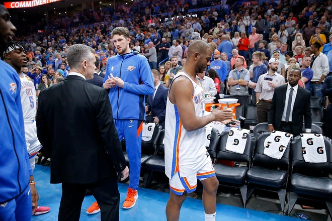 Oklahoma City coach Billy Donovan, Mike Muscala and Chris Paul leave the court with the rest of the team March 11, 2020, before an NBA game between the Oklahoma City Thunder and the Utah Jazz was postponed at Chesapeake Energy Arena in Oklahoma City. [Bryan Terry/The Oklahoman Archives]