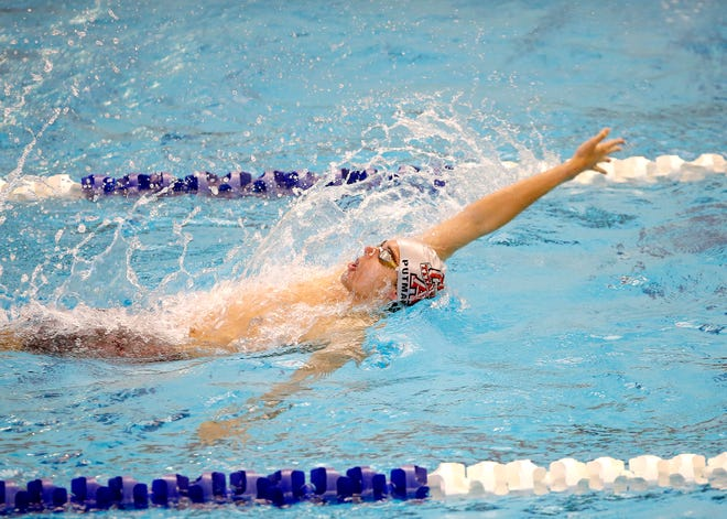 Carl Albert's Kaleb Putman competes in the 100-yard backstroke during the Class 5A state meet in Edmond on Feb. 23.