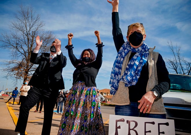 Julius Jones supporters Christopher Johnston, Valeria Benabdallah and Kathy Carson, from left, react to the vote of the Pardon and Parole Board during a vigil March 8 in Oklahoma City. The board voted to further review Jones' commutation request. [Chris Landsberger/The Oklahoman]