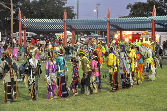 Dancers get ready to perform at a Standing Bear Powwow.