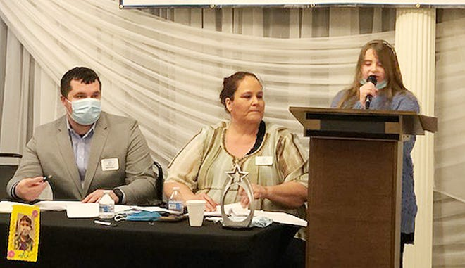 Elliana Jonsson, right, talks about the Boys and Girls Club organization during the Great Futures Breakfast at Walton Centre in Fairbury Wednesday morning while Kam Sallee and Jodi Martin listen.