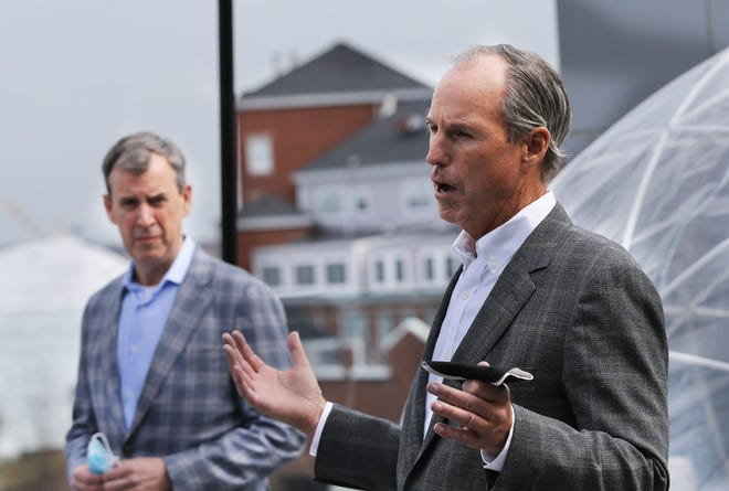 Jeff Johnston of Cathartes, left, and Mark Stebbins of XXS Hotels speak at a press conference announcing the Portsmouth Together 200 campaign. The two companies will match up to $100,00 in donations to the fund.