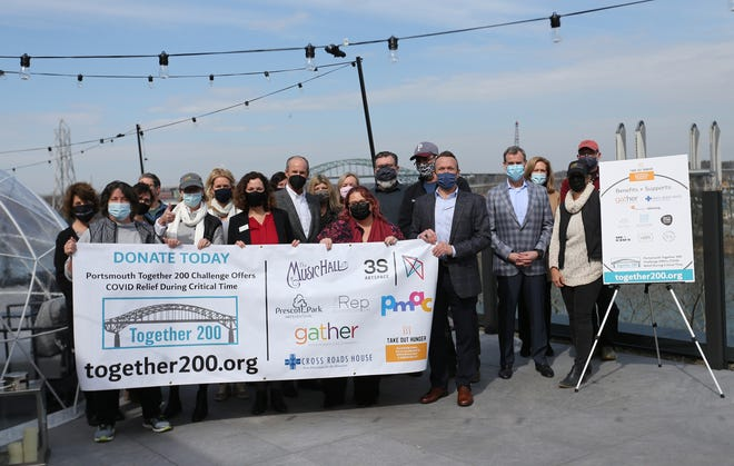 The development community joins together with Portsmouth's leading arts and hunger non-profits to raise $200,000 in 100 days to build a bridge over COVID. People gathered at the rooftop of AC Hotel for the kickoff March 11, 2021.