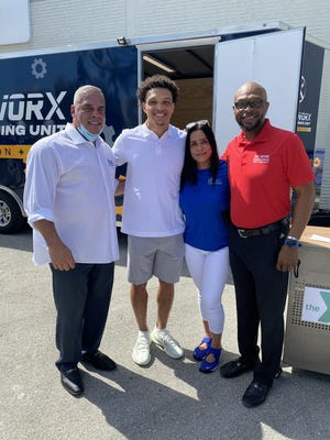 Present at the recent unveiling of Xcel Strategies Mentoring Network's new WORX Mobile Training Unit were (left to right): Tom Rivera, Regional Director, Xcel Strategies; Willie Snead IV, wide receiver, Baltimore Ravens; Maribel Roman, Mentor, Xcel Strategies; Willie Snead III, former NFL wide receiver