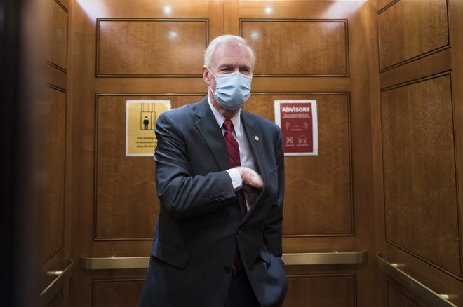 Sen. Ron Johnson, R-Wis., steps into an elevator as the Senate holds a voting marathon on the Democrats' $1.9 trillion COVID-19 relief bill that's expected to end with the chamber's approval of the measure, at the Capitol in Washington on March 5. When the Senate took up the measure on March 4, Johnson forced an extraordinary half-day holdup on the bill by demanding the chamber's clerks read aloud the entire 628-page measure which took 10 hours and 44 minutes and ended shortly after 2 a.m.
