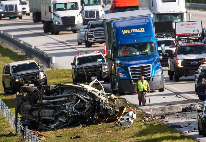 Authorities investigate the crash in which two people died early Thursday on the Florida's Turnpike in Palm Beach Gardens, March 11, 2021.The crash took place in the northbound lanes north Hood Road just before 6 a.m. The crash involved three trucks: a tractor-trailer, a pickup and a utility truck, FHP said.