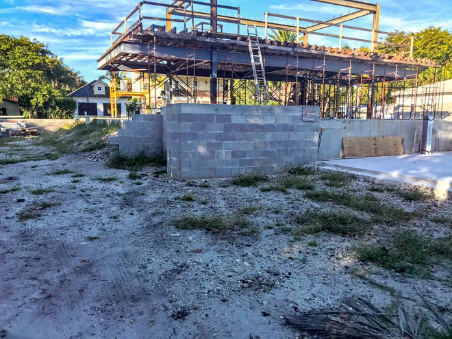 The new owners of the Sewell Biggs home on Seabreeze Avenue demolished the historic structure without city permits. The owners have said they are committed to making the house look very much like it did in 1955.