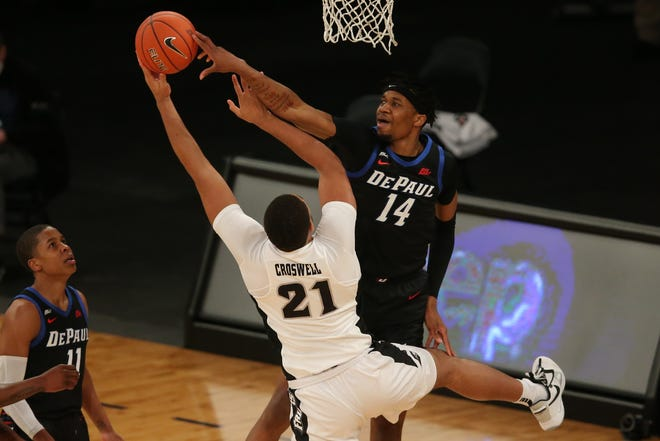 DePaul center Nick Ongenda blocks a shot by Providence's Ed Croswell during the first half Wednesday night at Madison Square Garden in New York.