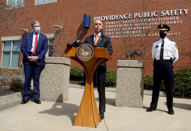 Providence Mayor Jorge Elorza, center, with Public Safety Commissioner Steven Paré and Police Chief Hugh T. Clements Jr., holds a news conference outside the Providence Public Safety Complex on Thursday.