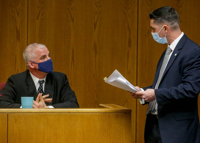 Special Assistant Attorney General Michael McCabe questions Sgt. Joseph Hanley on Thursday.
