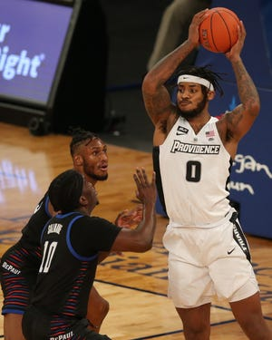 Friars center Nate Watson (0) controls the ball against DePaul guard Ray Salnave and forward Pauly Paulicap last season during the Big East Tournament in New York. PC will take part in the Gavitt Games this fall.