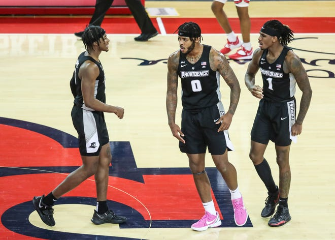 Providence Friars David Duke, left, Nate Watson, center, and forward Greg Gantt convene on the court during the game on March 3 against St. John's at Carnesecca Arena in Queens, N.Y. Duke and Watson were named to the All-Big East second team.
