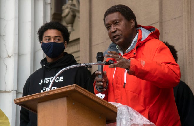 Attorney John Burris, right, speaks at a rally for 17-year-old Devin Carter, left, in front of City Hall in downtown Stockton. Burris said in January that he intends to file a federal lawsuit against the Stockton Police Department and City of Stockton alleging Carter was assaulted by police without justification