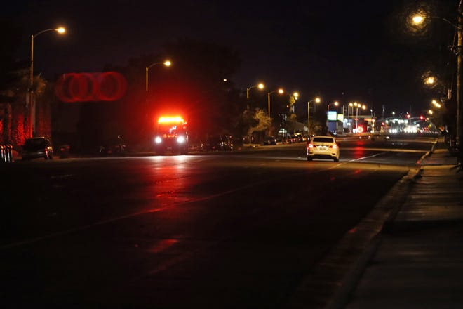 Liberty Ambulance races down Ridgecrest Blvd. at around 7:30 p.m. on Wednesday night, heading to the scene of a rollover crash on Highway 178.