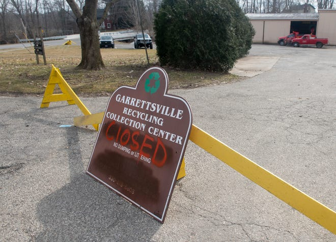 A sign is posted, notifying visitors to the Garrettsville Street Department at 8314 Water St. that the recycing drop-off area is closed. Mayor Rick Patrick said the bins were removed because of illegal dumping and noise, as well as the potential rising cost of the program.