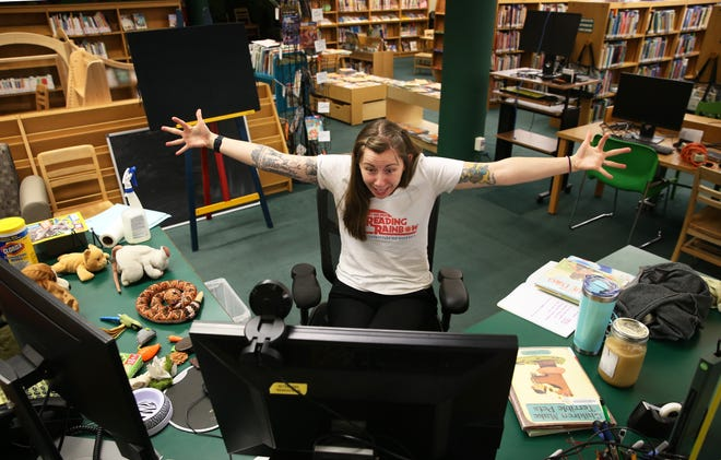 Springfield Youth Services Librarian Taylor Worley sings a song with children over the internet during story time.