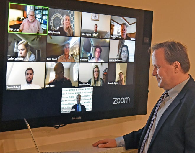 Dr. Cihan Cobanoglu, professor and director of the M3 Center for Hospitality Technology and Innovation at USF's Muma College of Business, joins a ZOOM meeting. The center offered a free certificate program to help employees in the industry position themselves for a post-pandemic economy.