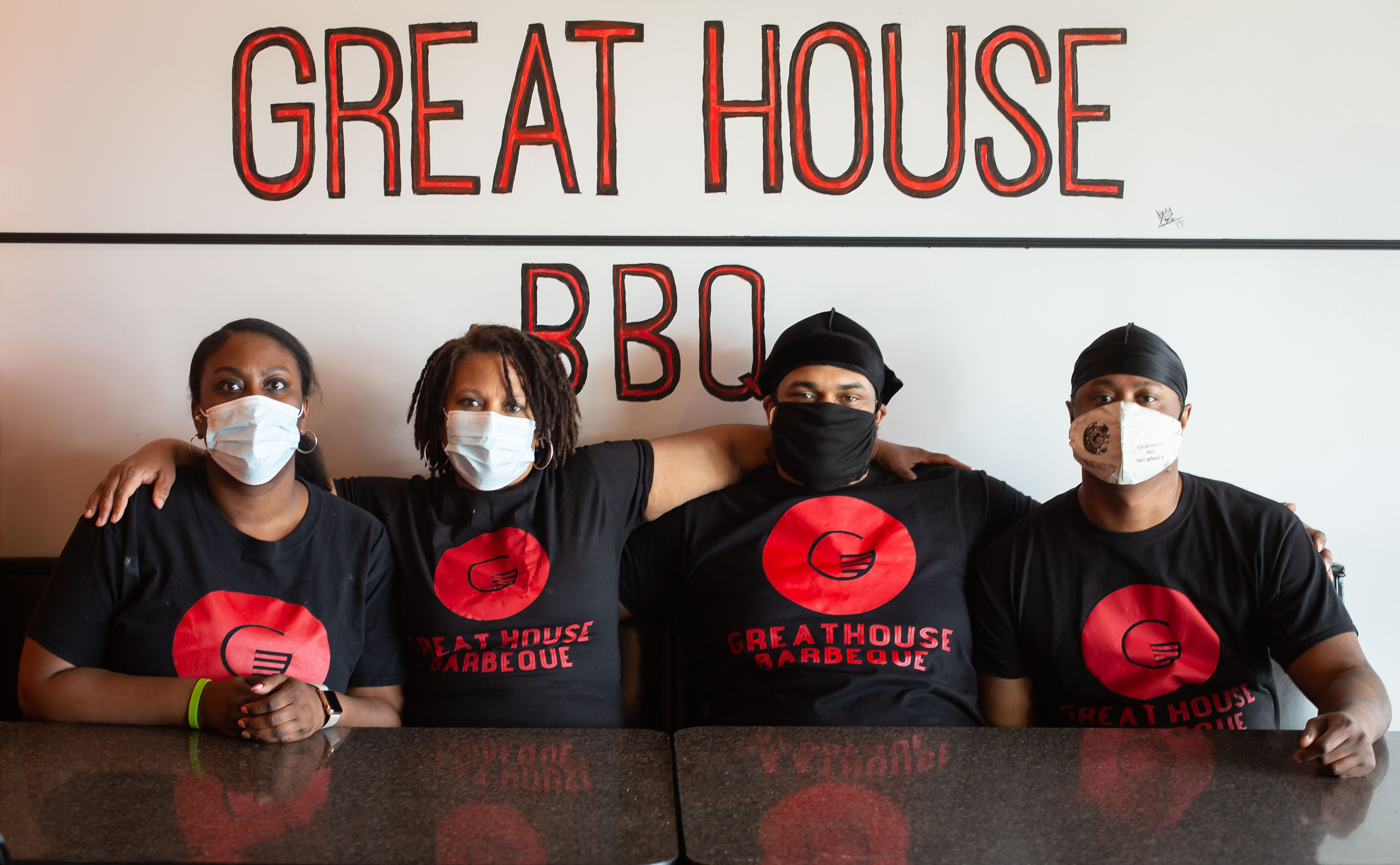 It's a family affair for Great House BBQ with Di'Anna Mitchell, left, mother, Renatta Dunigan, and brothers Benjamin Frazier and Kurtis Mitchell, right, that are partners in the BBQ restaurant at 4233 Wabash Ave. The restaurant faced tough times through the COVID-19 pandemic, but found help through the generosity of donations from a GoFundMe campaign that was started by a friend of Renatta Dunigan. [Justin L. Fowler/The State Journal-Register]