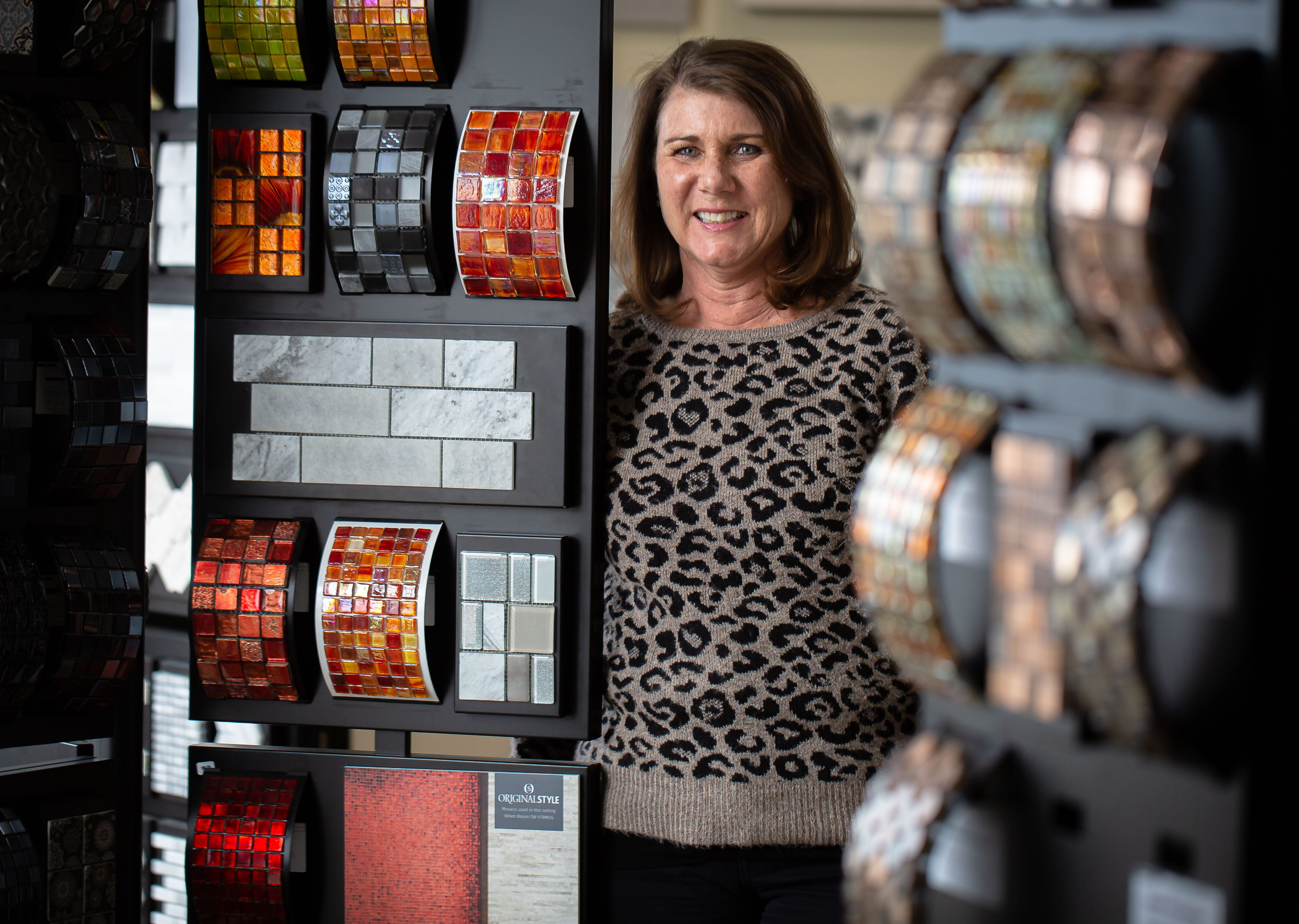 Sheryl Daugherty, the owner & president of Arizona Tile Company, on the showroom floor in Springfield, Ill., Thursday, March 11, 2021. Sheryl Daugherty, has owned Arizona Tile Company for the last 25 years with her husband, Cary, and was initially worried about being able to continue to pay her employees through the shutdown caused by the COVID-19 pandemic. [Justin L. Fowler/The State Journal-Register]