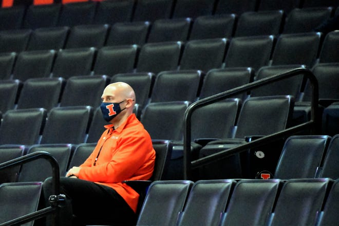 Illinois athletic director Josh Whitman watches the Illini take on North Carolina A&T in the arena empty on Wednesday, Nov. 25, 2020, in Champaign.