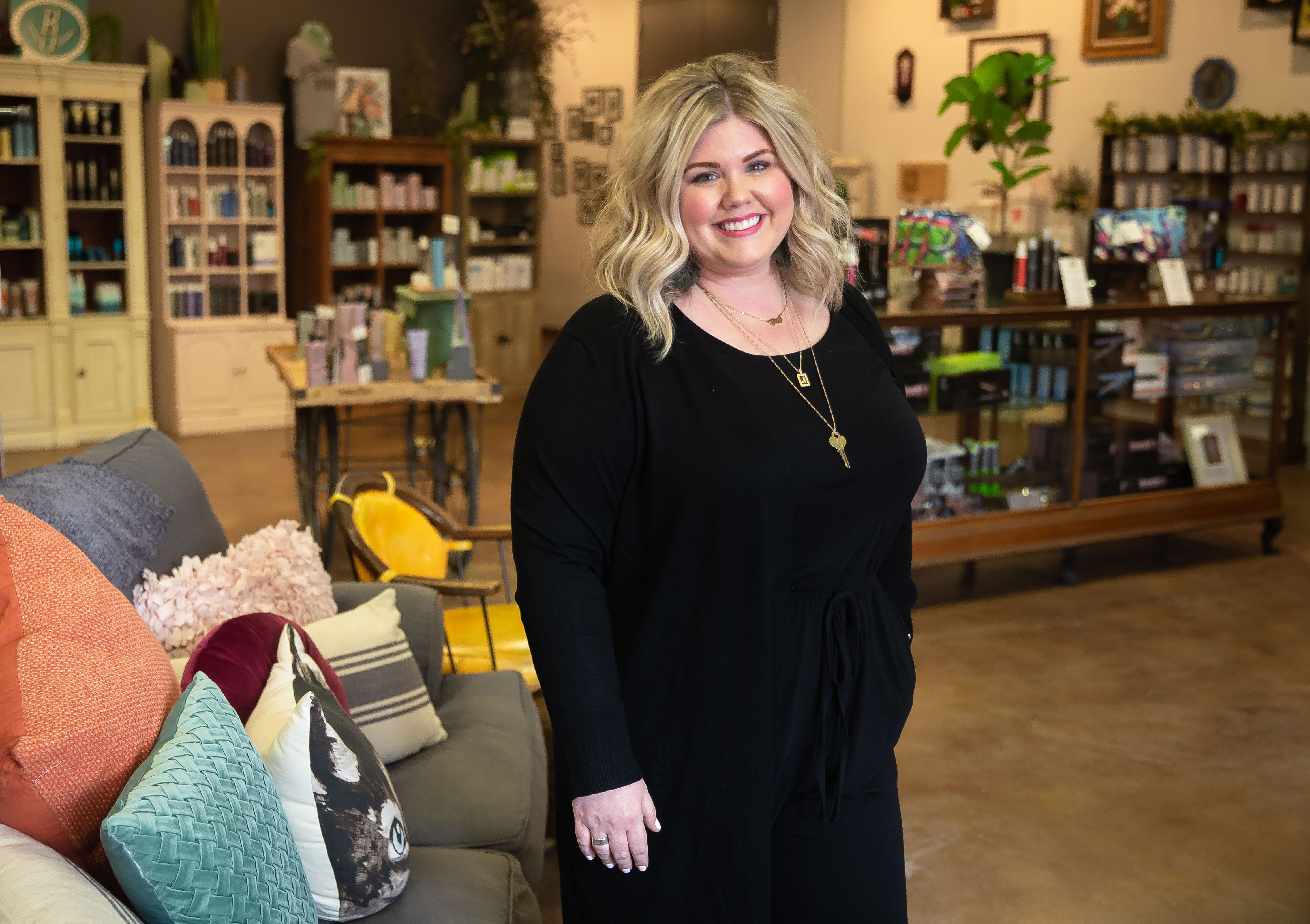"""Jessica Kocurek, owner of Willow & Birch, in the showroom of the boutique at Willow & Birch in Springfield, Ill., Wednesday, March 10, 2021. Kocurek """"made lemonade"""" out of the COVID-19 pandemic as she shifted to online sales and delivery of items from her boutique while the salon was forced to shutdown because of mitigations put in place to try and stop the spread of the virus. [Justin L. Fowler/The State Journal-Register]"""
