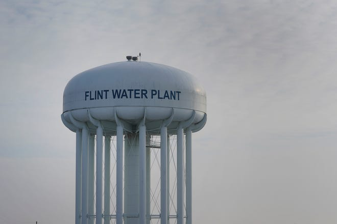 FILE - This Jan. 13, 2021 file photo shows the Flint Water Plant tower in Flint, Mich.  Lawyers who negotiated a $641 million settlement for victims of Flint  lead-contaminated water are asking a judge to set aside up to 32% for fees and expenses. If granted, the request would total $202 million in fees and $7 million in expenses for dozens of attorneys suing the state of Michigan, Flint, a hospital and an engineering firm.  (AP Photo/Paul Sancya, File)