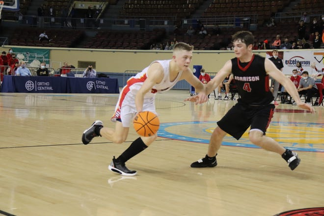 Dayton Forsythe looks for an opening in the Morrison defense Thursday in the opening round of the Class 2A State Tournament at the Jim Norick State Fair Arena in Oklahoma City.