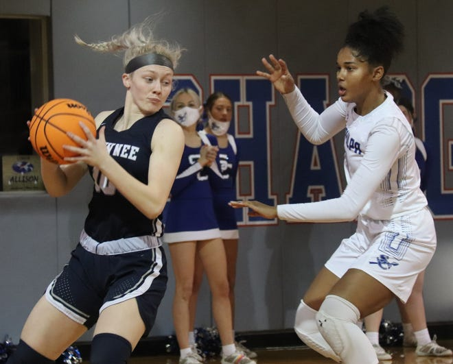 Shawnee's Aubrie Megehee (left) posts up against a Sapulpa defender Thursday in the first round of the Class 5A Girls' State Basketball Tournament at Tulsa Memorial High School.