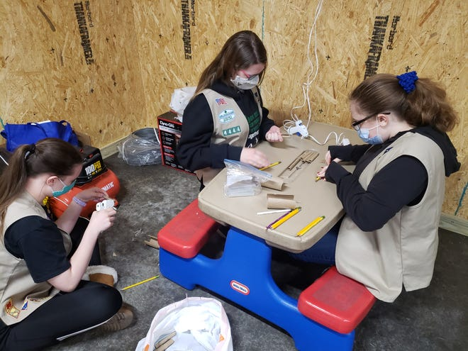 Scouts from Troop 4444 worked on parts for a bee hotel, a place where bees can check in to relax. The bee hotels are part of a bee survival kit the troop is making to achieve a Silver Service Award. From left: Addison Looney and Lilly Clark, (7th-graders) and Keira Hudson, (9th grade).