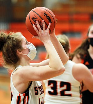 Juliette Schroeder heads up for two points