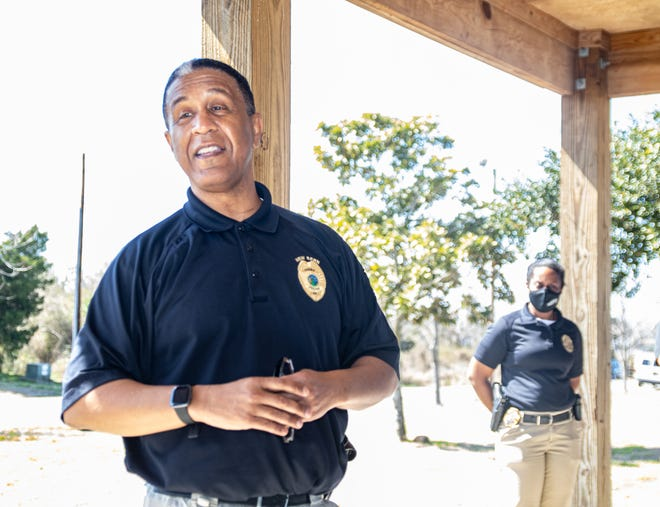 Retiring New Bern Police Chief Toussaint Summers Jr. speaks to a gathering of friends from local churches who have gathered at Lawson Creek Park to wish him luck on his soon-coming retirement.