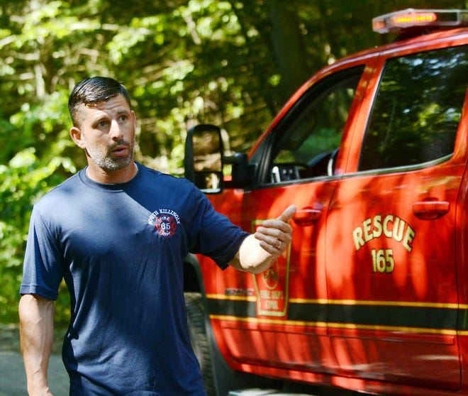 Chief Seth DeAngelis of the South Killingly Fire Department talks about numerous big holes in the Ross Road access road last August 10th that the department would like repaired so they can get to emergencies faster. [John Shishmanian/ NorwichBulletin.com]