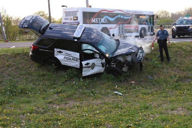 Topeka's city government has paid a $335,000 settlement in a lawsuit over an April 2016 traffic crash involving a Topeka police officer, whose damaged vehicle is shown in this photo.