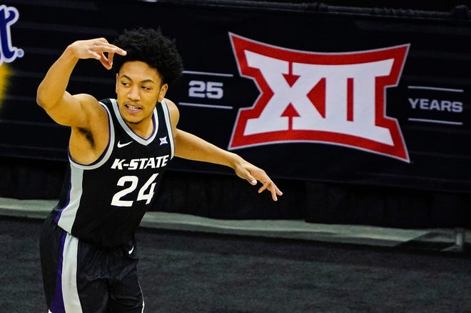 Kansas State guard Nijel Pack reacts after scoring in the second half of a Big 12 Tournament quarterfinal matchup against Baylor on Thursday at T-Mobile Center in Kansas City, Mo. Pack hit six 3s and finished with 18 points, but the No. 9-seeded Wildcats fell 74-68.