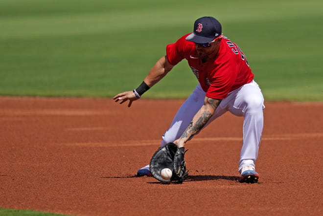 Michael Chavis  fields a ground ball as a first baseman against the Rays during an exhibition game earlier this month.