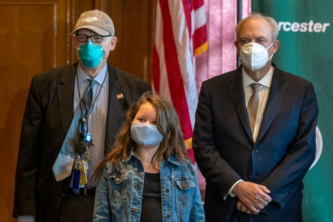 Savannah Magner is the first place winner of the Mayor's Mask Up Challenge. She received her award from Dr. Michael P. Hirsh, the city's medical director, and Mayor Joseph M. Petty during the weekly COVID-19 update at City Hall Thursday.